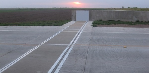 passive flood barrier extends levee across road