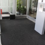 FloodBreak pedestrian gate covered with carpet in building vestibule