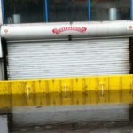 A FloodBreak Vehicle Gate protected the dealership's inventory parked below street level