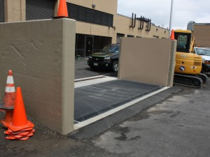 FloodBreak passive flood barrier in recessed position protecting the service entrance