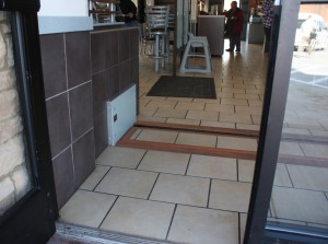 FloodBreak matched the interior floor tile to cover the passive flood barrier