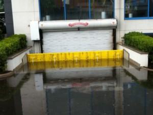 FloodBreak passive flood barrier deploys automatically to block street flooding from entering garage