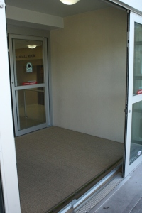 passive flood barrier with polished concrete wiper wall