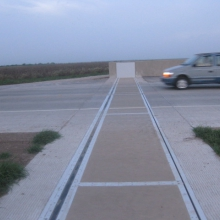 Extend levees without raising roadways with FloodBreak passive floodgates