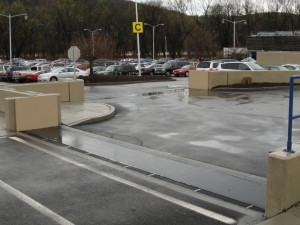 FloodBreak passive flood barriers integrated into floodwalls in parking lot