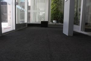 FloodBreak passive flood barrier hidden beneath carpet