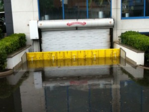 FloodBreak passive flood barrier deploys automatically to block street flooding from entering garage